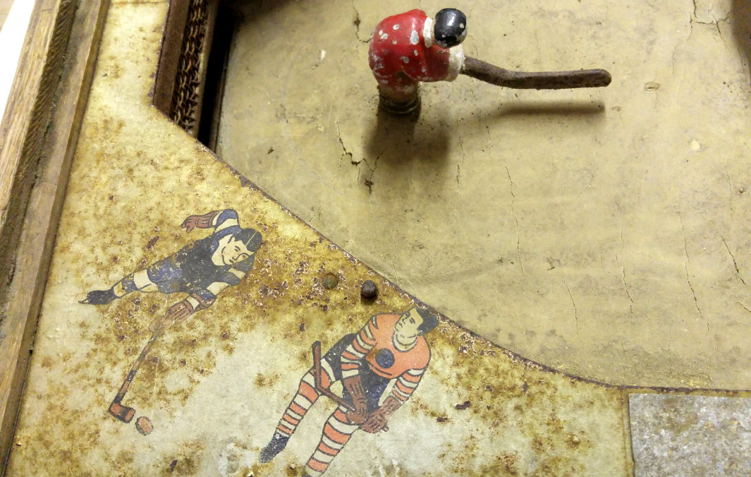 hockey players painted on an old table hockey game