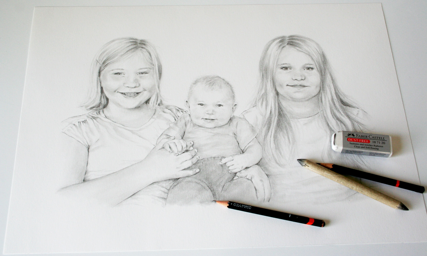 Photo of my pencil drawing of three children
