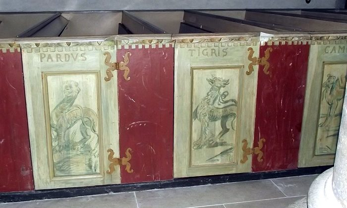 Medieval paintings on church bench doors with monsters and beasts, Gotland Sweden